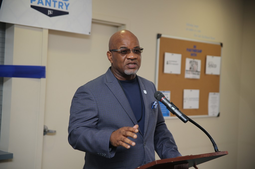 JSU President Dr. William B. Bynum, Jr., expresses his admiration for his wife, Deborah Bynum, during the ribbon-cutting ceremony for her food pantry initiative. (Aron Smith/University Communications)