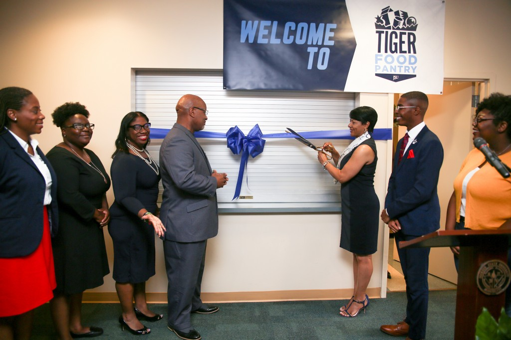 Deborah Bynum, first lady of JSU, prepares to cut the ribbon on the Tiger Food Pantry while surrounded by campus partners who aided in the initiative. (Photo by Aron Smith/University Communications)