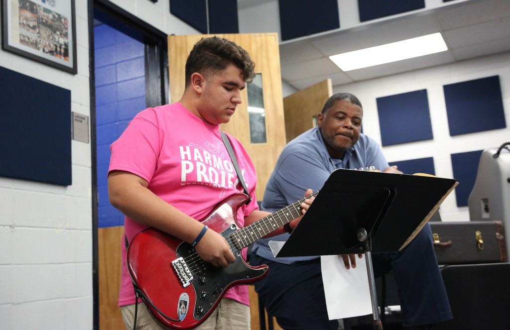 Established nearly 17 years ago in Los Angeles County, the Harmony Project is a nonprofit that provides free musical instruments and lessons to children from low-socioeconomic backgrounds. Every student also plays in an ensemble or orchestra. One L.A. student receives guidance from a JSU instructor during the group's three-day visit to the campus. (Photo by Kentrice S. Rush/JSU University Communications)