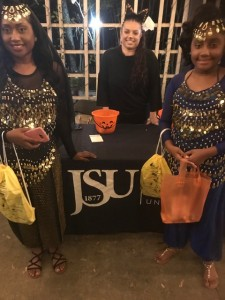 Heather Wilcox, center, assistant director of CUBD, was part of the JSU crew distributing candy and supporting the zoo's fundraiser during Boo at the Zoo. Positioned near the tiger exhibit, she's joined by a two participants dressed as gypsies.
