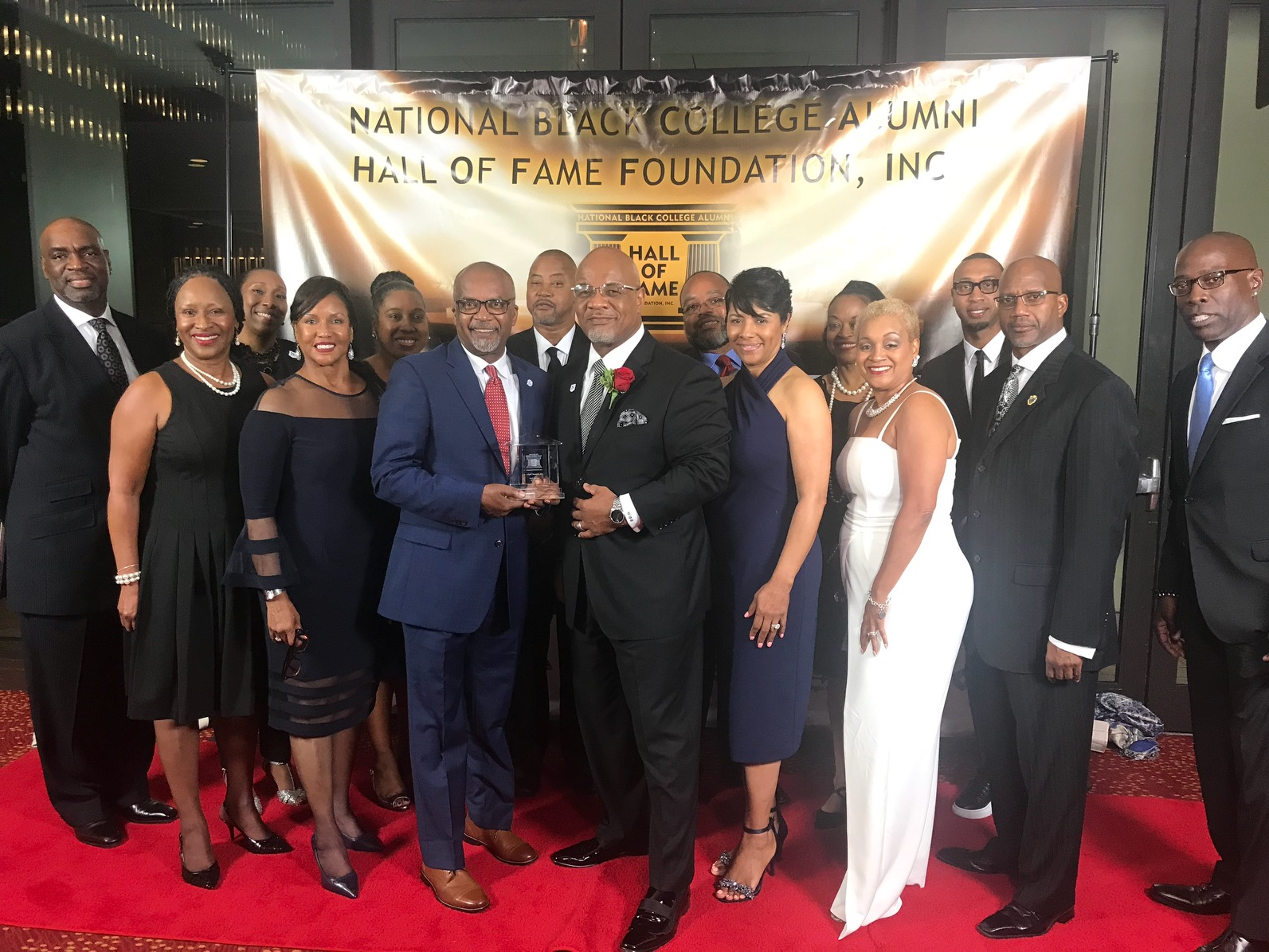 Hall of Fame honoree Dowell Taylor, director of bands, is congratulated by JSU President William B. Bynum Jr. and first lady Deborah Bynum during a recognition in Atlanta. Others celebrants include employees and alumni of Jackson State University.