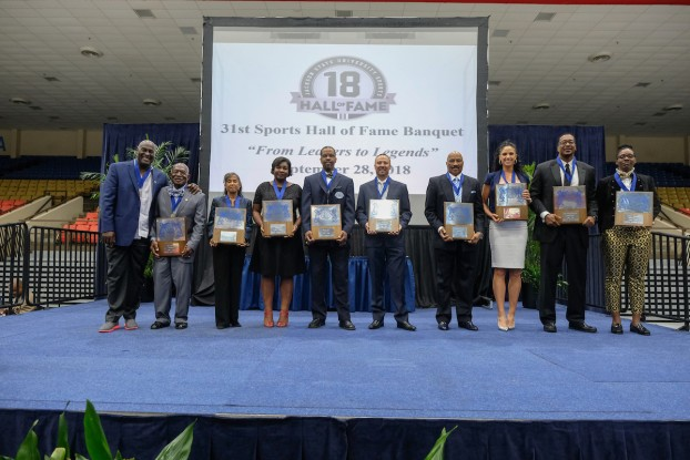 """From Leaders to Legends:"" Honorees showcase their plaques and medallions during the 31st Sports Hall of Fame Banquet. The event was held Friday, Sept. 28, in the Lee E. Williams Athletics and Assembly Center. (Photo by Charles A. Smith)"