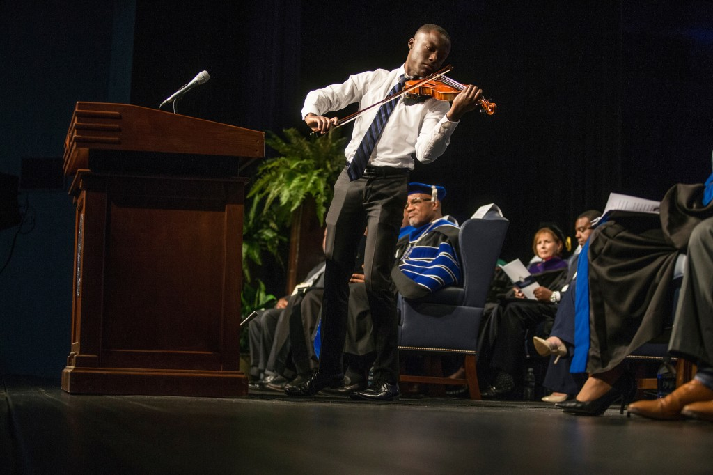 Violinist John Uzodinma gave a moving tribute to Dr. William B. Bynum Jr. that brought the audience to their feet during the investiture service that was filled with music and testimonies. (Photo by Charles A. Smith/JSU)