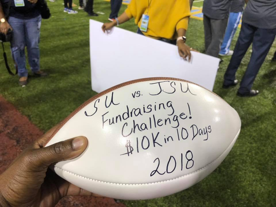 JSU versus SU game day ball presented during half-time acknowledging JSU as the fanraising champion!