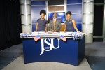 Media studies students Cianna Reeves (left), Clement Gibson and Gabrielle Baker (right) put their interview skills to the test during election night coverage at the Mississippi e-Center at JSU. (Photo by Rachel James-Terry/JSU)