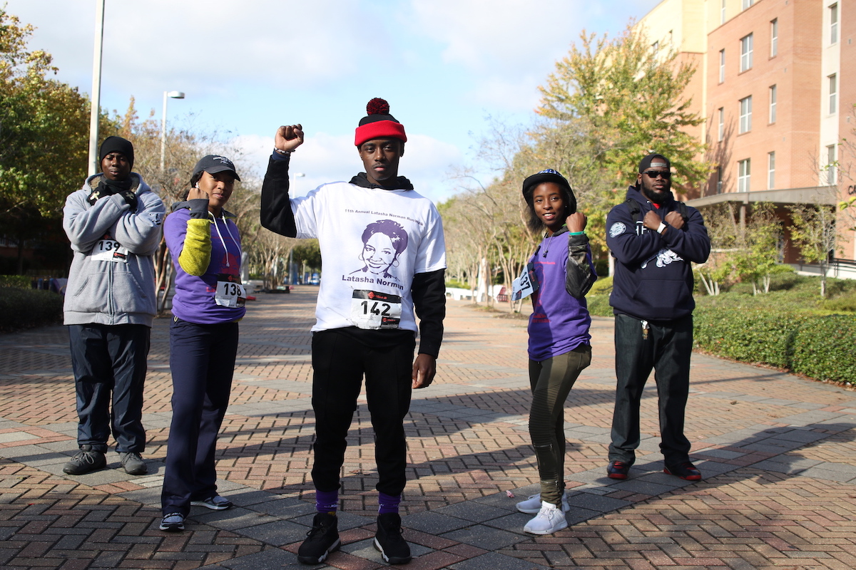 Blue and White Flash staffers join in bringing awareness to domestic violence and abuse. They are Aaron Walker, left, a senior from Jackson; Deja Davis, a junior from Atlanta; Clement Gibson, a senior from Minneapolis, Minnesota; Shay Humphrey, a senior from Marks; and Darrius Barran, a junior from Chicago. (Photo by Aron Smith/JSU)