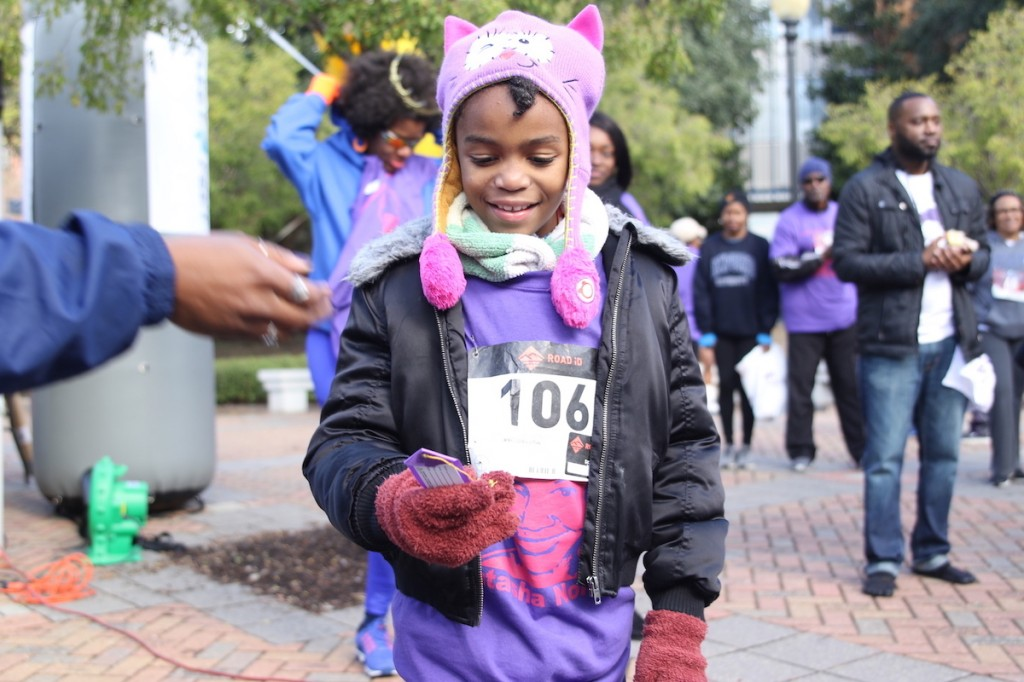 A young participant earns recognition for her time. (Photo by Aron Smith/JSU)