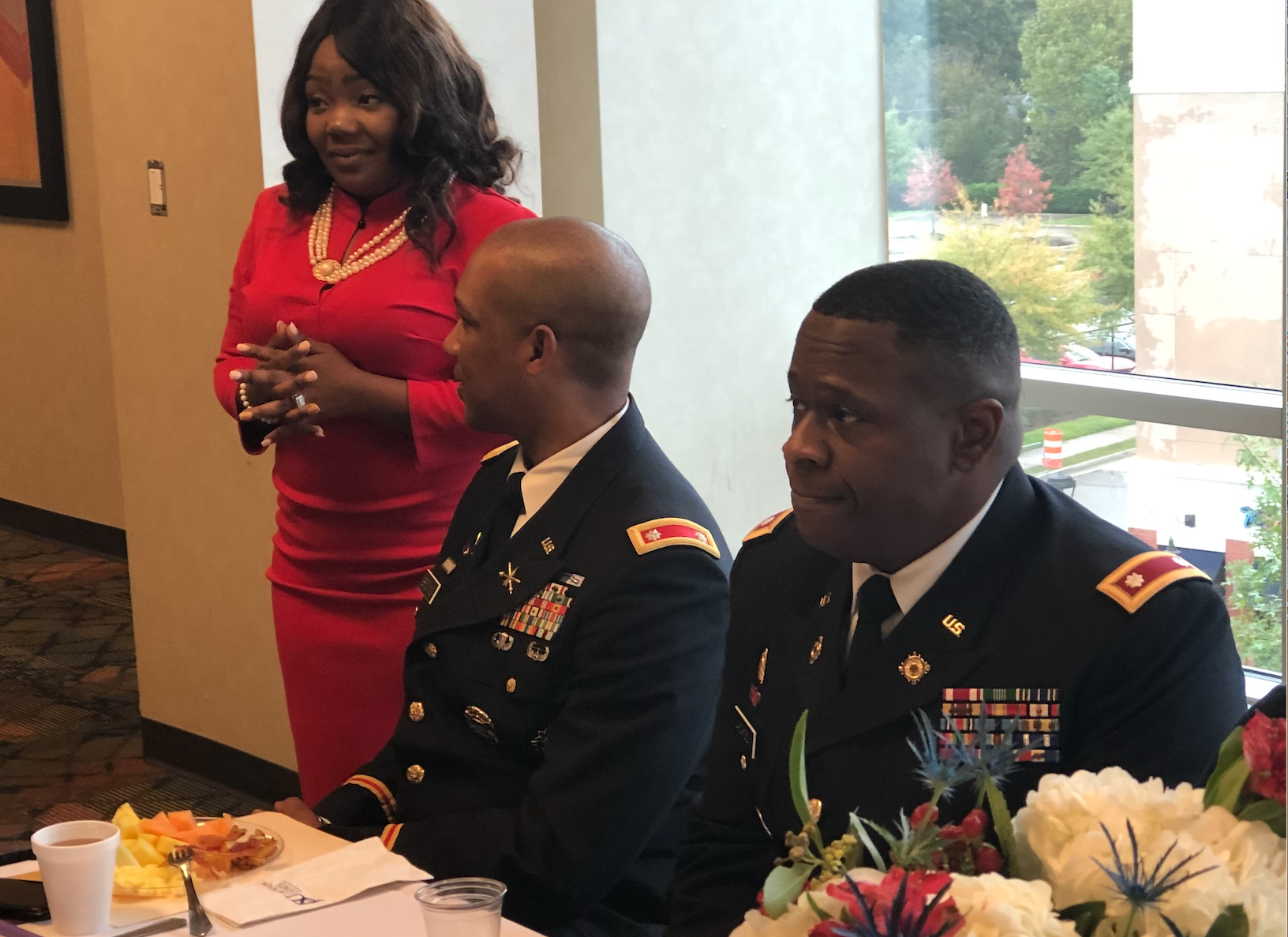 Dr. LaToya Reed, director of JSU's Veteran and Military Student Support, consults with Brookins  as the observance prepares to begin with keynote speaker Jackson, right. (Photo by L.A. Warren/JSU)