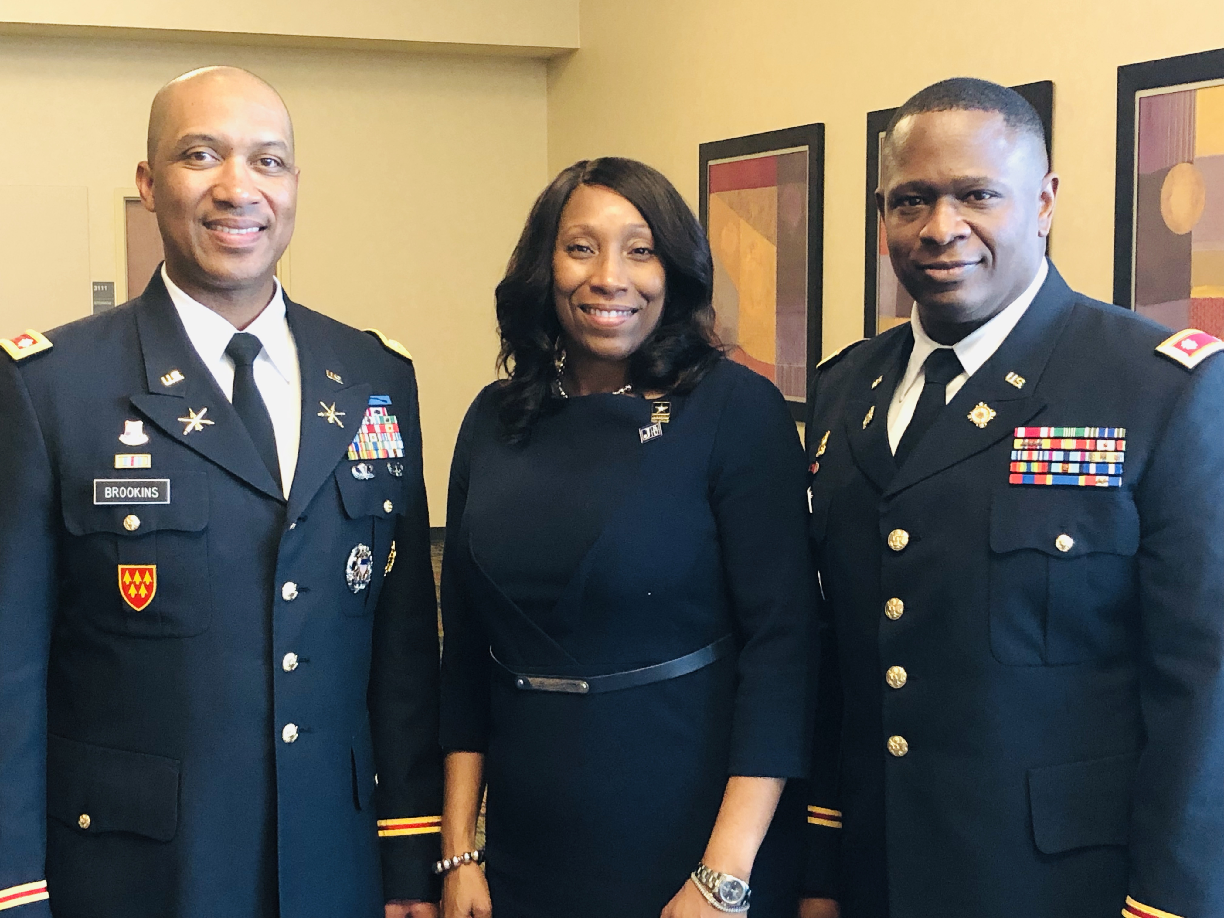 Lt. Col. Dexter M. Brookins, chair and professor of the Department of Military Science, welcomes keynote speaker Lt. Col. G. Torrie Jackson Jr., who's accompanied by his wife Debra Mays-Jackson, vice president and chief of staff for JSU. The military officer delivered the Veterans Day address Friday. (Photo by L.A. Warren/JSU)