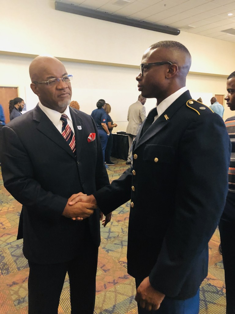 JSU President William B. Bynum Jr. greets Christopher Hines, a JSU graduate cadet studying criminology. Hines aims to give back to the community and the U.S. through 25 years of service and ultimately as a general. (Photo by L.A. Warren/JSU)