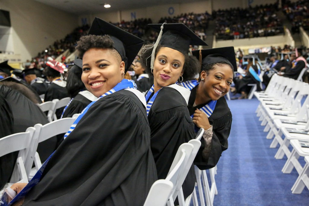 Graduates pose while waiting to receive their degrees. ( Aron Smith/University Communications)