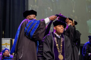 Dr. Herman Felton, Jr., president of Wiley College is hooded during the fall 2018 commencement exercise. (Charles A. Smith/University Communications)