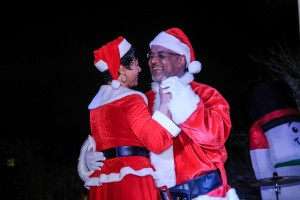 """Mr. and Mrs. Claus show what the holiday is all about: """"L-O-V-E."""" (Photo by Charles A. Smith/JSU)"""