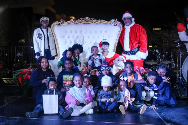 Santa Claus (JSU President William B. Bynum Jr.), Mrs. Claus (Deborah Bynum), Mister JSU Darrian Johnson and Miss JSU Gabrielle Baker spread holiday cheer with community children. (Photo by Charles A. Smith/JSU)