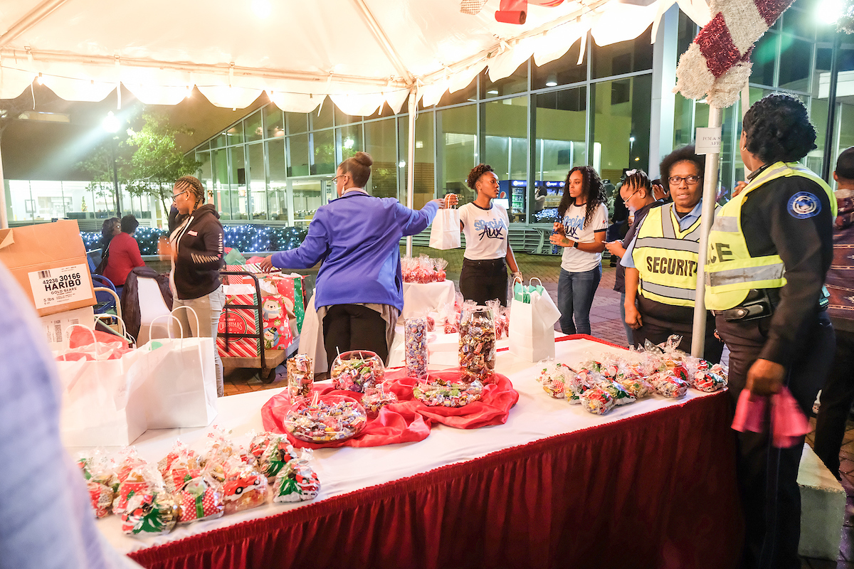 JSU staff prepare holiday treats before the start of the annual Holidays Under the Stars. (Photo by Charles A. Smith/JSU)