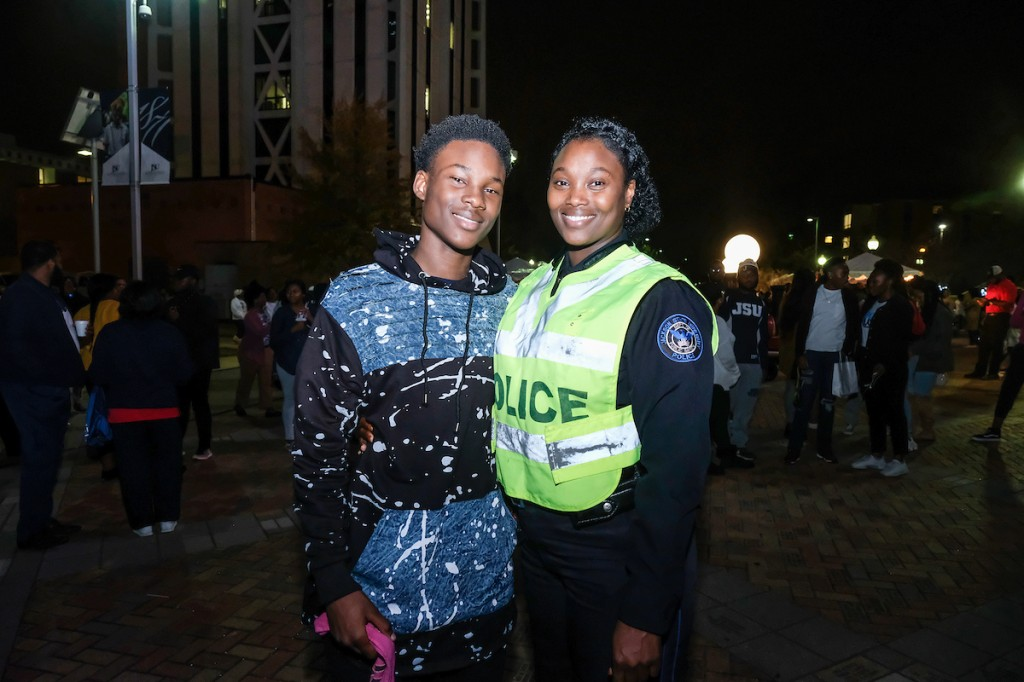 """: JSU Public Safety officer Salisha Jordan and her 14-year-old son Adonis experience their first Holidays Under the Stars. Adonis was so captivated by the entertainment that he said, """"This is an event I would recommend to everyone I meet."""" His mother described it as a nice and sweet occasion for the students at JSU and the community."""" They both will spend the holiday in Atlanta and North Carolina. (Photo by Charles A. Smith/JSU)"""