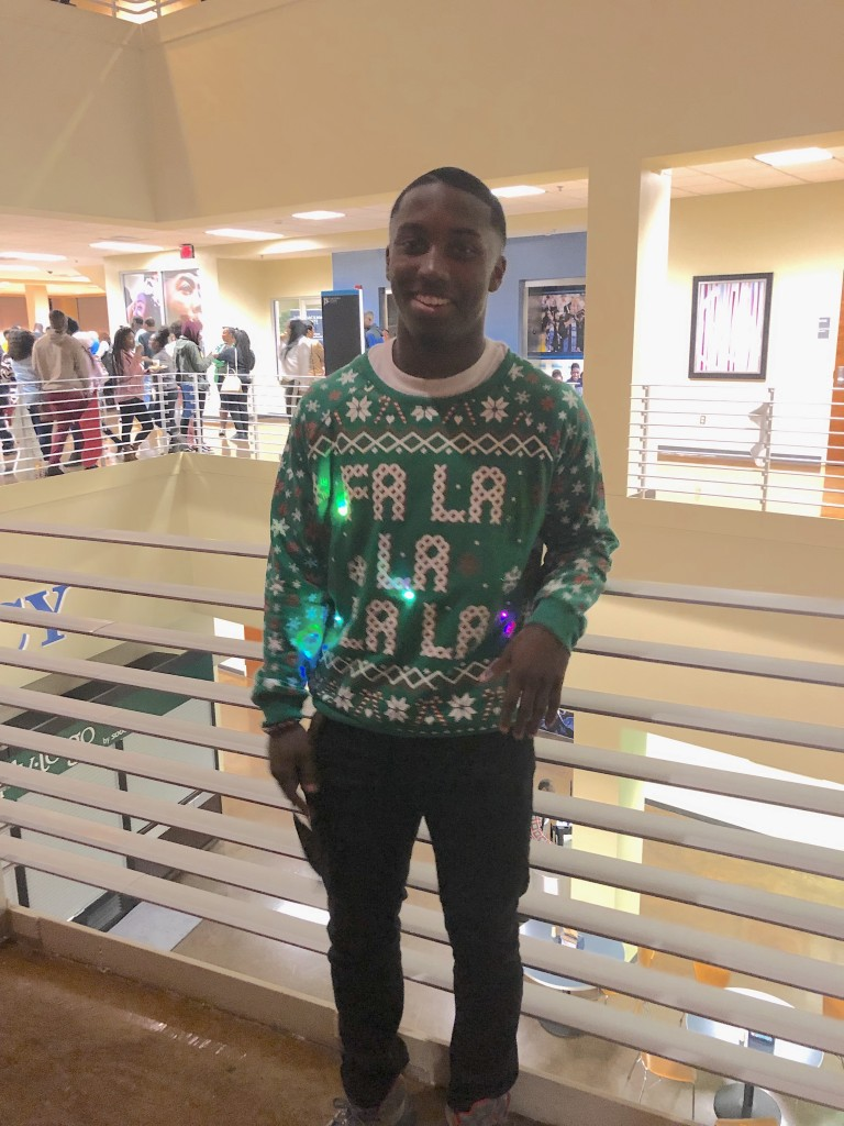 With his sweater, SGA vice president Jordan Jefferson helps brighten the holidays. (Photo by L.A. Warren)