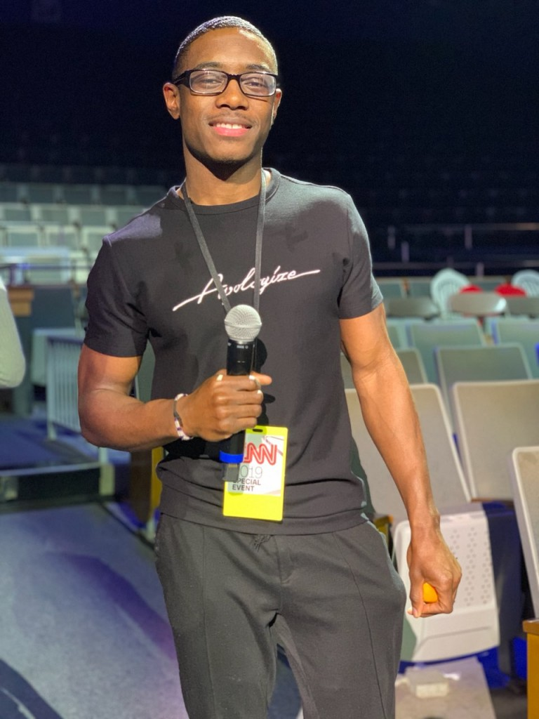 "Clement Gibson, a senior from Minneapolis, described his experience of working with CNN for the live broadcast as a ""perfect opportunity"" because he's an aspiring filmmaker. He also helped set up Warren's dressing room. (Special to University Communications)"