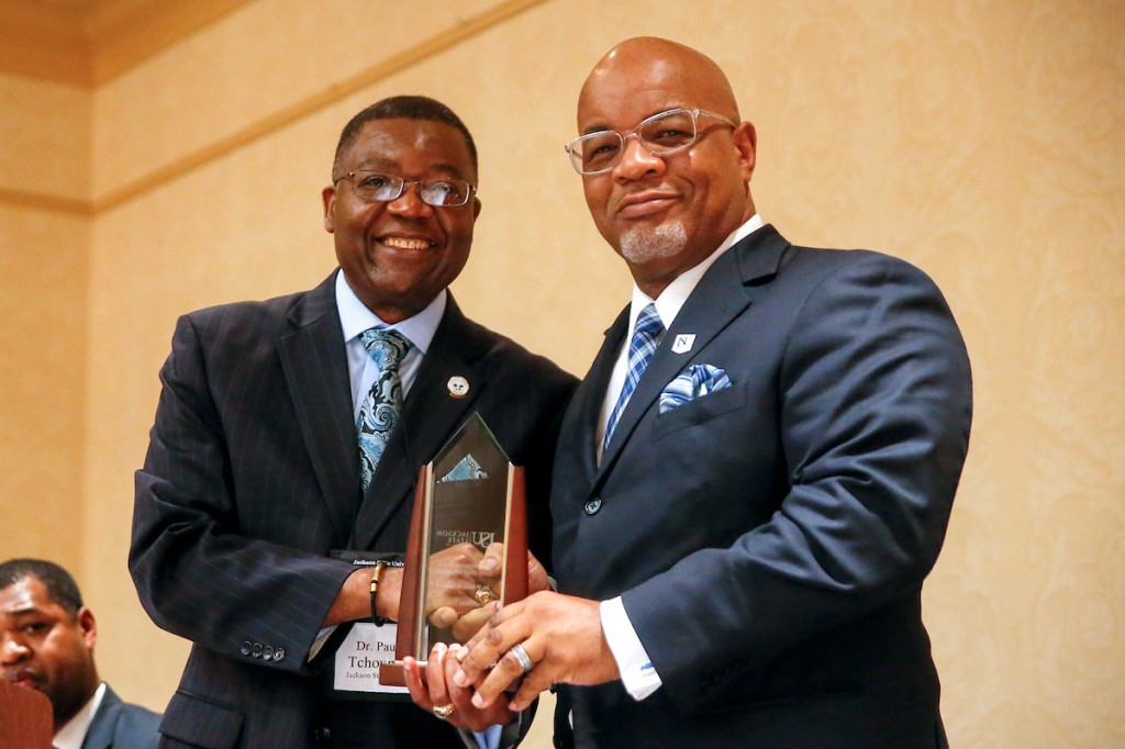 Symposium chair and JSU professor Dr. Paul Tchounwou honors JSU President William B. Bynum Jr. for supporting research. (Photo by Charles A. Smith/JSU)