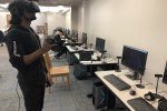Anthony Gomes, a JSU graduate student in computer science from Bangladesh, is experimenting with various applications. He will train to become a VR curator and teach others. (Photo by L.A. Warren/JSU)
