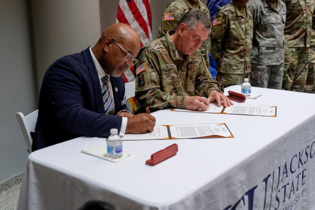 JSU President William B. Bynum Jr. joins Maj. Gen. Janson D. Boyles in signing a Memorandum of Understanding with the Mississippi National Guard to offer the Tiger Free Tuition Program. (Photo by Charles A. Smith/JSU)