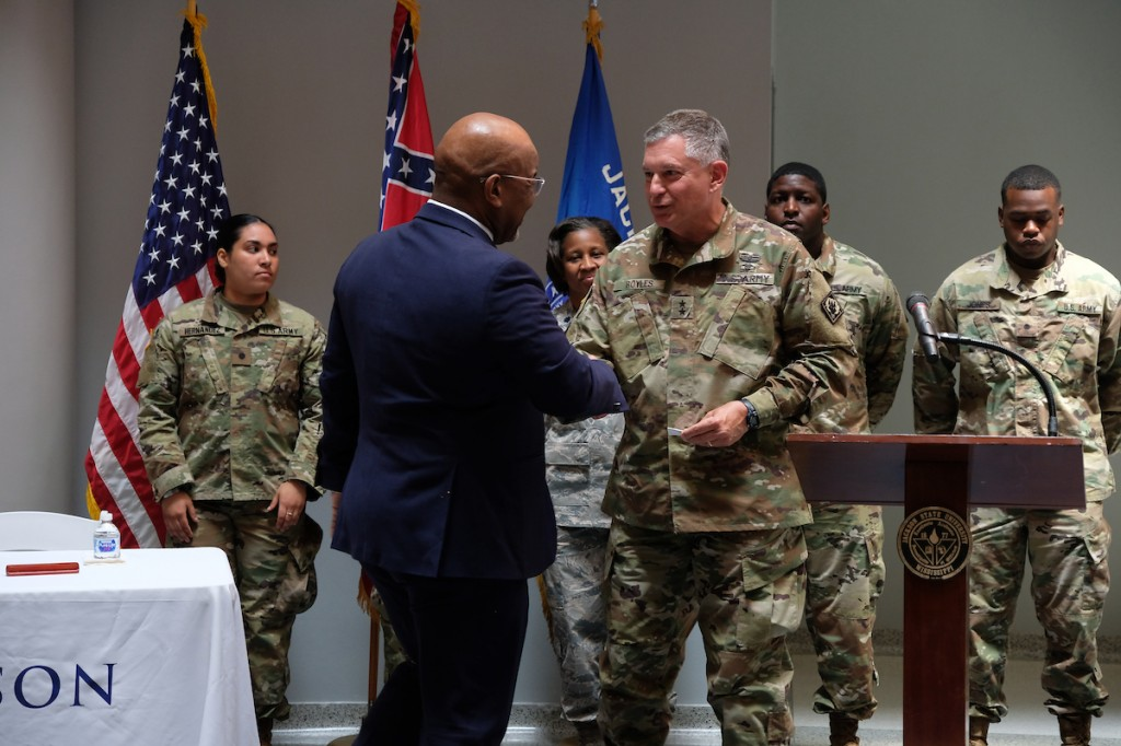 Bynum and Boyles seal the deal with a handshake and agree that quality education will improve the readiness and leadership of the men and women serving in the Mississippi National Guard. (Photo by Charles A. Smith/JSU)