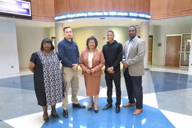 Pictured from (Left to Right): Janice May, Thay Montgomery, Dr. Sheila Porterfield, interim dean for the College of Business, Cordarius Robinson and  Larry Day, visiting instructor for Finance.