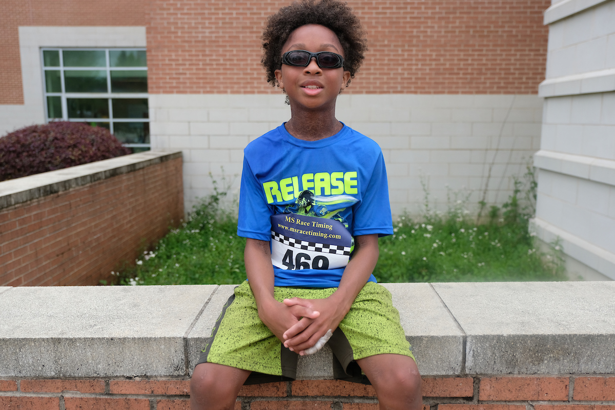 Eleven-year-old Jackson White, a Bailey APAC Middle School student, finished big by coming in third overall and first in his age group. He said he expects to be a future Olympian. (Photo by Aron Smith/JSU)