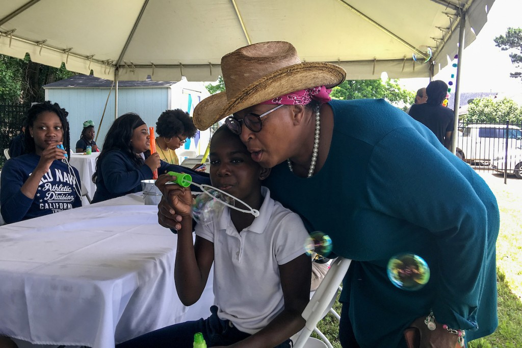 Feeling a little bubbly, a patron gets in on the fun with one of Blackburn's students. (Photo by Charles A. Smith/JSU)