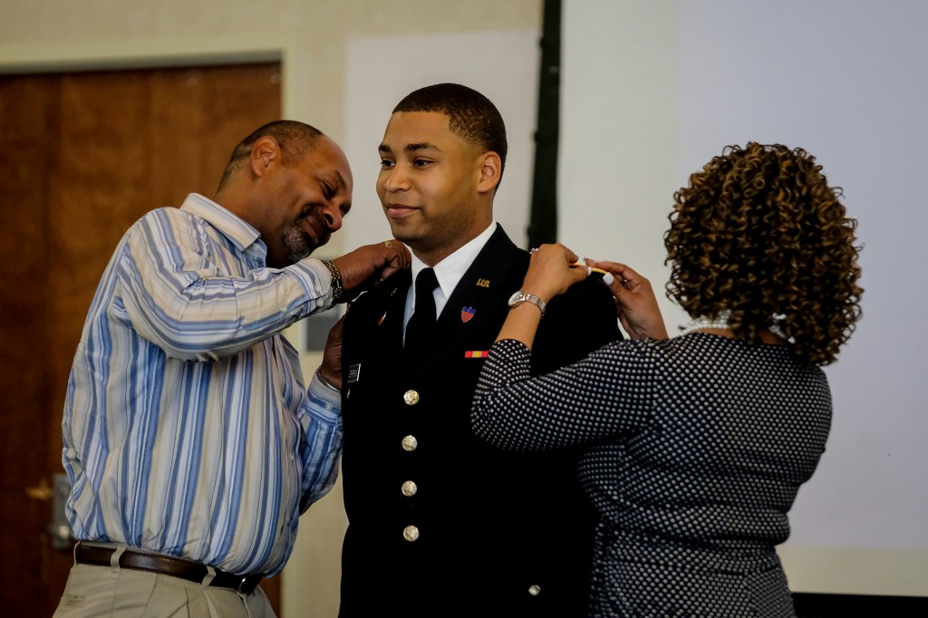 James A. Jefferson, a graphic design major, who graduated on May 4, is pinned by his parents during the commissioning ceremony. (Photo by Charles A. Smith/JSU)