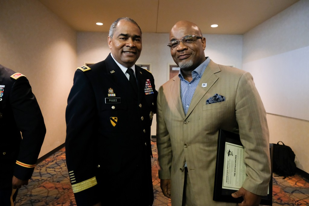 William B. Bynum, 11th president of Jackson State University, pauses from congratulating the cadets to take a picture with Lt. Gen. Aundre F. Piggee, keynote speaker, for the Tiger Battalion, class of 2019, on May 2. (Photo by Charles. A. Smith/JSU)