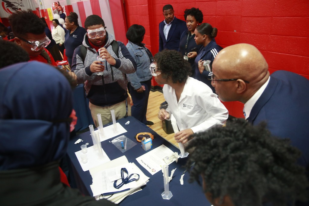 Bynum observes as a North Panola student participates in an experiment. (Photo by Charles A. Smith/JSU)