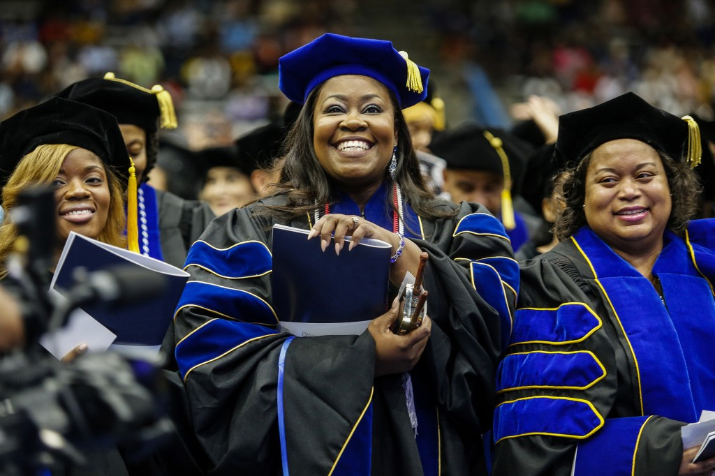 Students are all smiles upon receiving their degrees at Friday's commencement ceremony.