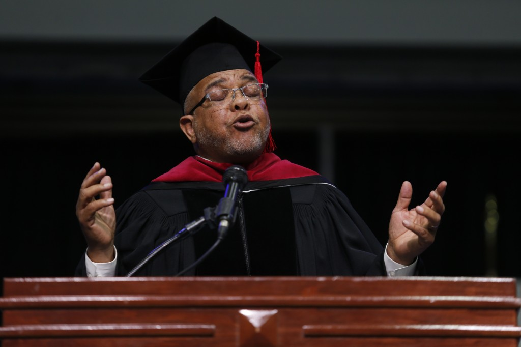 "Commencement speaker Crudup encourages the crowd to ""Be Darn Good""."