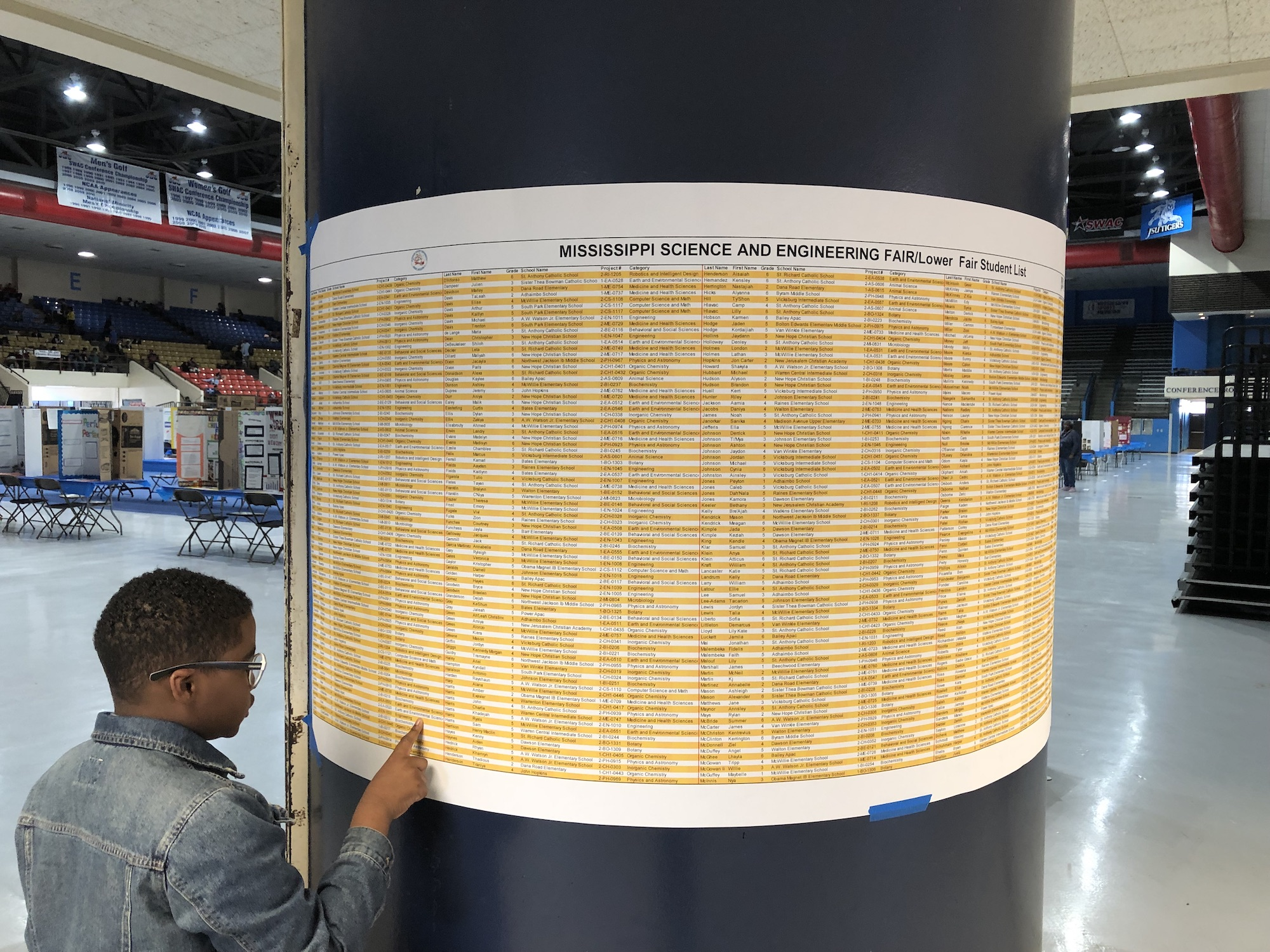 A student checks names of participants at the Region II Mississippi Science and Engineering Fair this spring. Participants represent six counties: Claiborne, Copiah, Hinds, Madison, Rankin and Warren. (Photo by L.A. Warren/JSU)