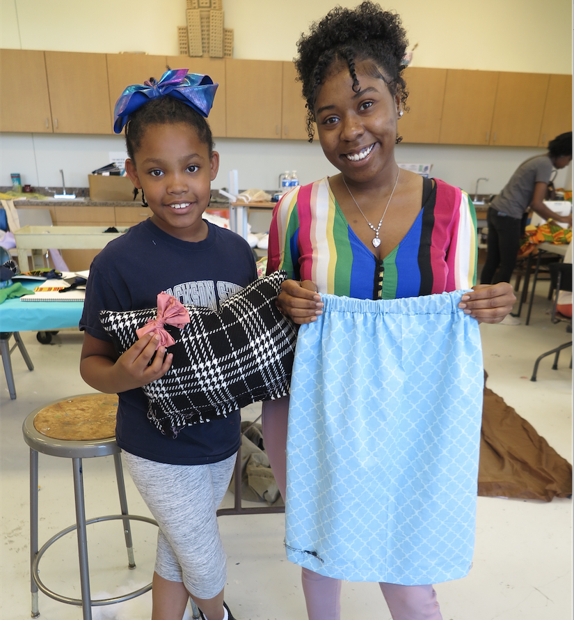 "Heiress Frazier (left) is a fourth grader at Green Elementary. ""I like all the people at the camp. I also really love that we're making dresses, pillows and bows,"" said Frazier, pictured with Jayah Alexander, an instructor for the camp. (Photo by Rachel James-Terry/JSU)"