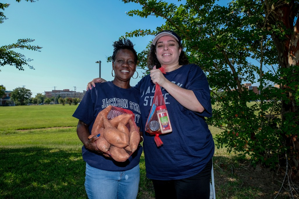 Terry Bennett (left), prevention specialist for Metro Jackson Community Prevention Coalition, and Heather Wilcox, director of community engagement at JSU, shared that they were ecstatic by the number of people and volunteers who showed up for the event. (Photo by Charles A. Smith/JSU)