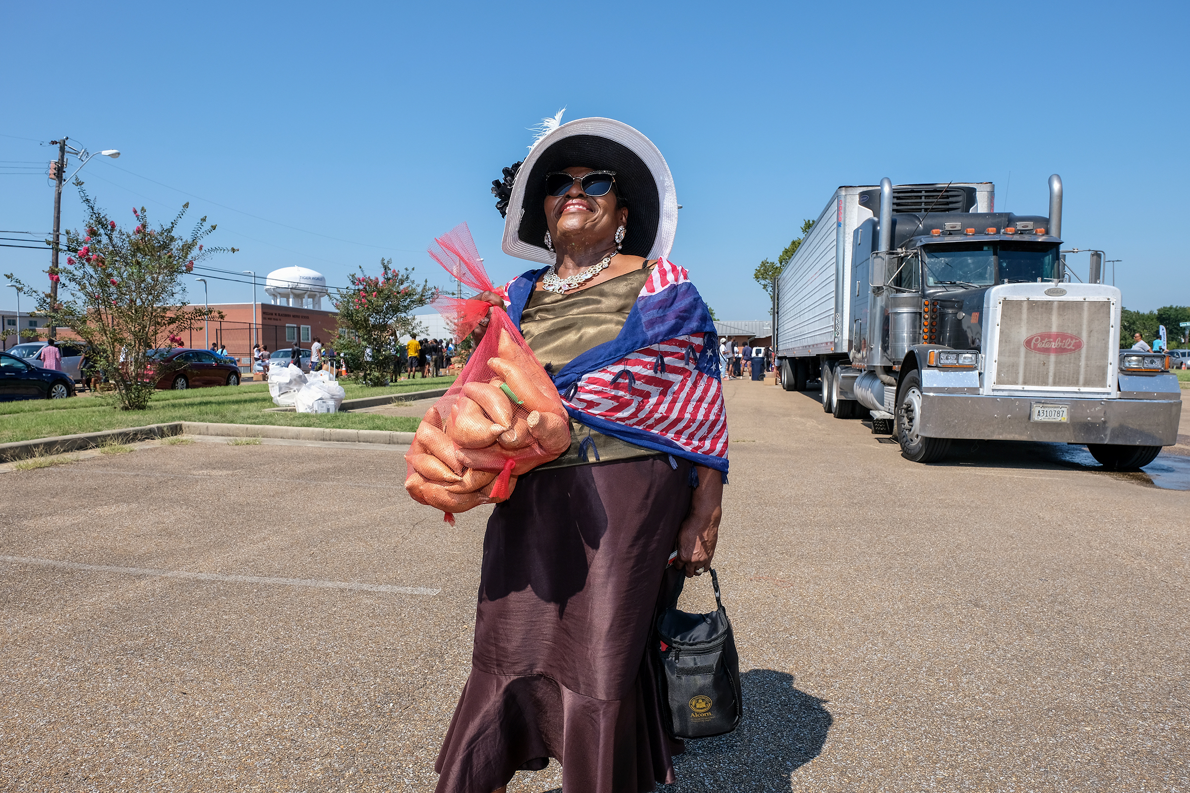 "Addie Green, a native of Jackson, stopped by the 2019 Crop Drop and scooped up a bag of taters. ""This is a remarkable event. It's well organized and a good turnout despite the heat,"" said Green, who is also running for state treasurer. ""I think it's excellent that they are utilizing the students and showing them how to give back to the community."" (Photo by Charles A. Smith/JSU)"