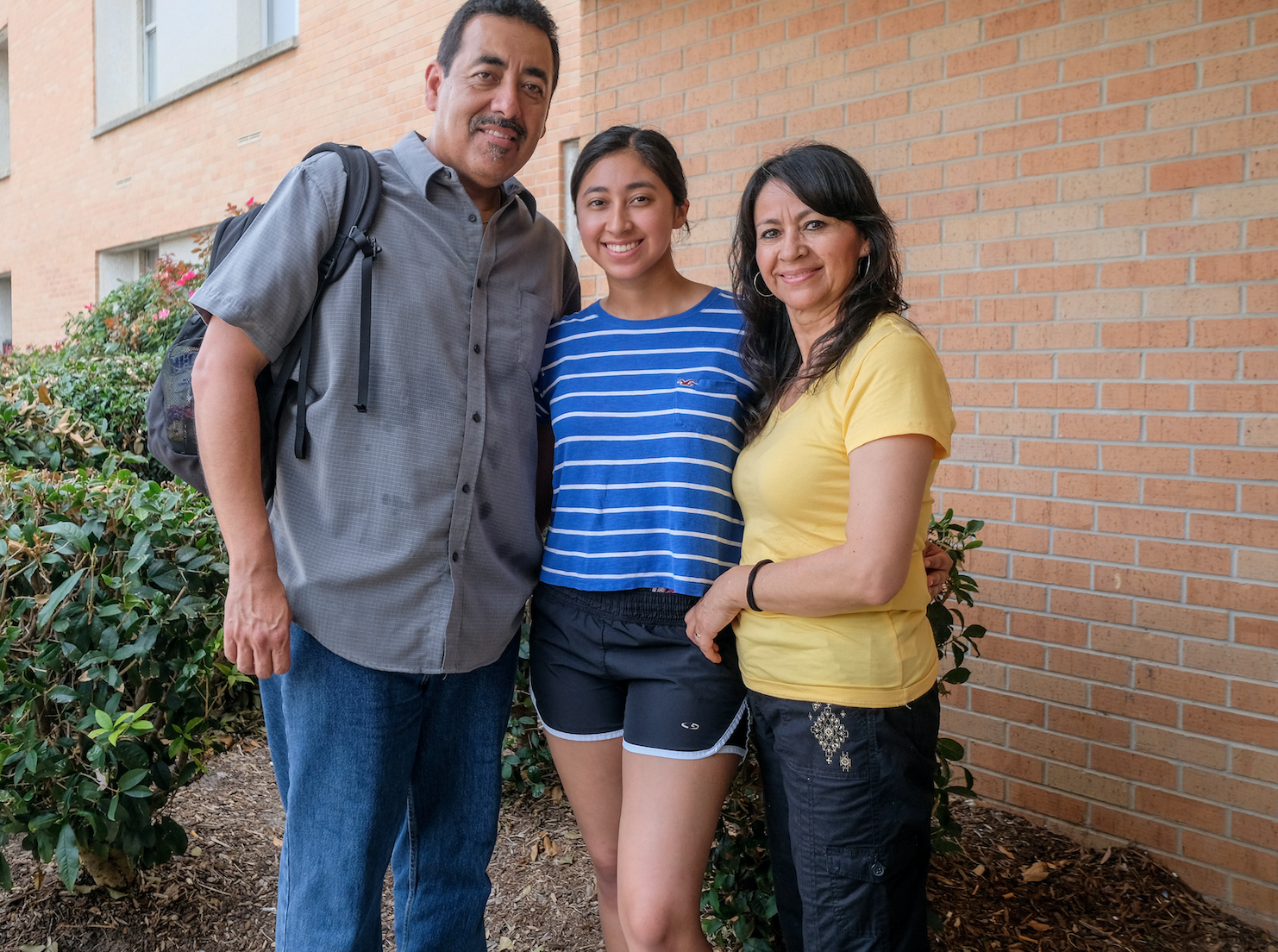 """If it was up to my parents, I would be attending college close to my home but they allowed me to make my own decision,"" says Monica Serrano. ""People who live in California have told me that I should come here so I know I'm in a good place."" Serrano is pictured with her mother and father. (Photo by Charles A. Smith/JSU)"
