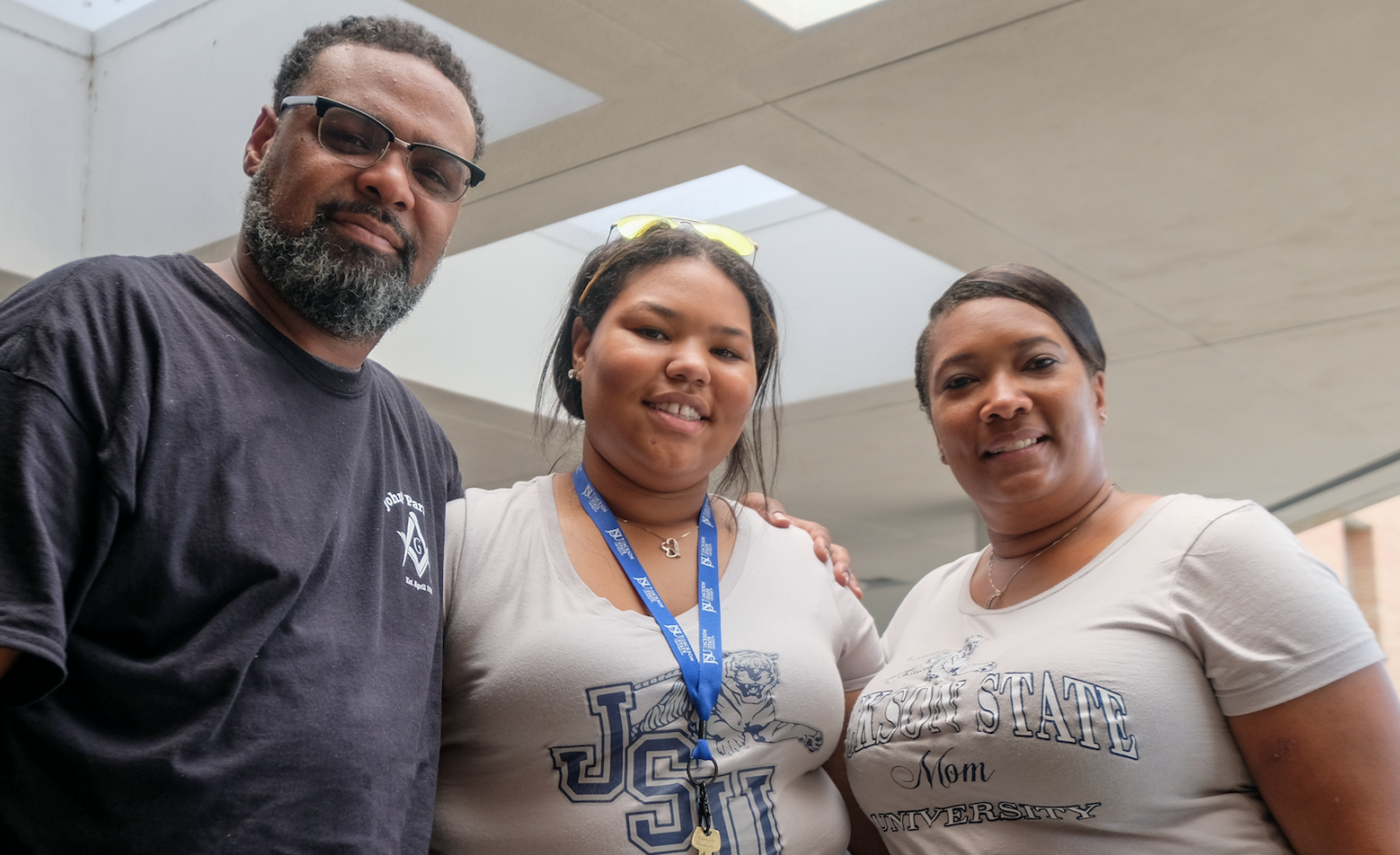 "Pictured with her parents, St. Louis native Kayla James says, ""I am looking forward to being away from home. My parents are going to miss me."" (Photo by Charles A. Smith/JSU)"
