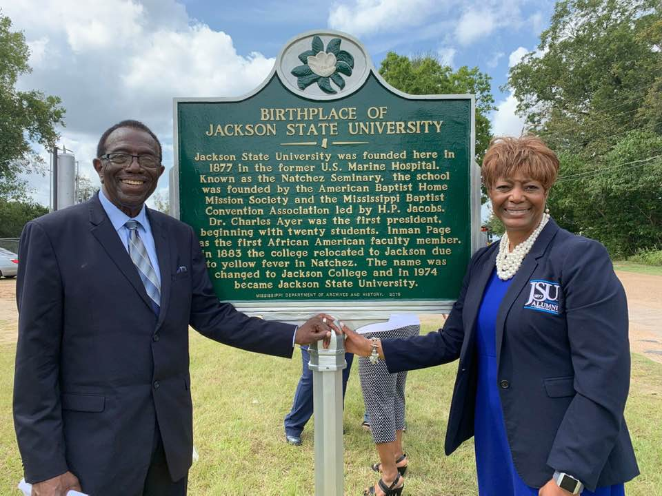 Alumnus and JSU professor Dr. Hilliard Lackey poses beside the marker with JSUNAA President, Dr. Earlexia Norwood.
