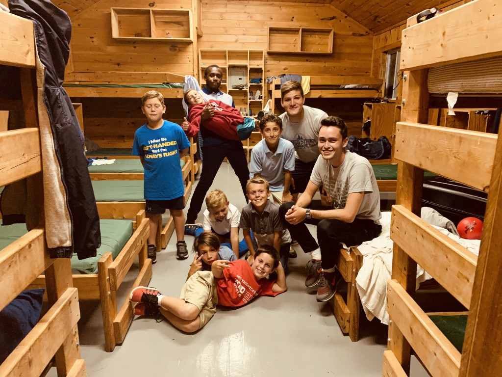 Jabaris Jefferson, a student at JSU, hangs out with his rambunctious band of campers inside their cozy digs at Iroquois Springs Summer Camp in Rockhill, New York. (Photo special to JSU)