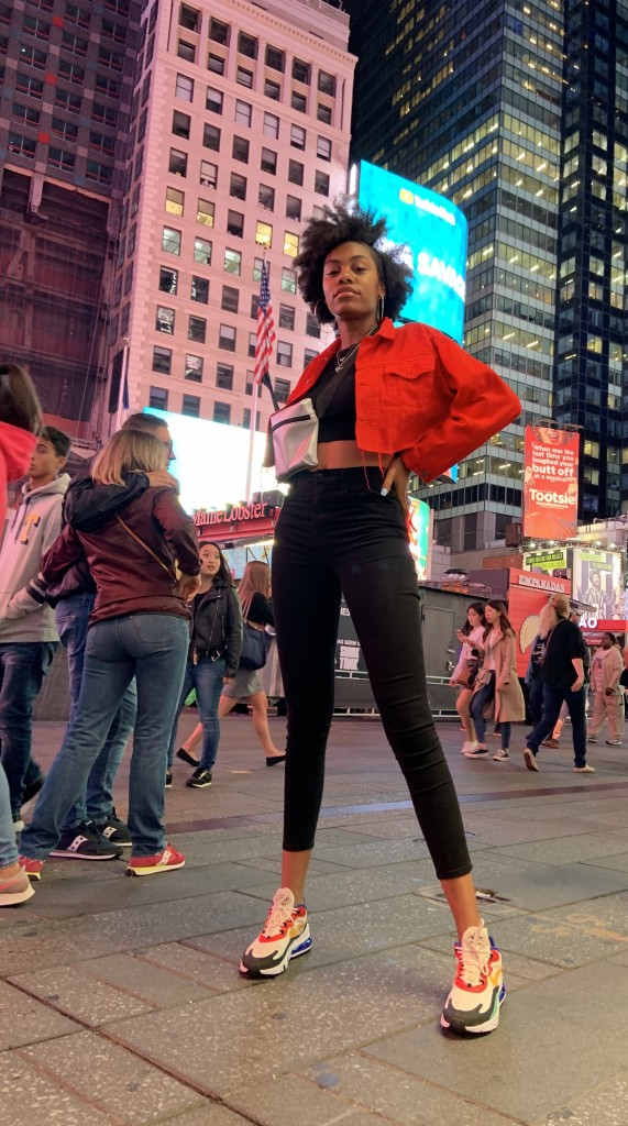"Olivia Howard stands in Times Square after walking in New York Fashion Week. She describes her experience as ""surreal"" and says ""it was a dream come true."""