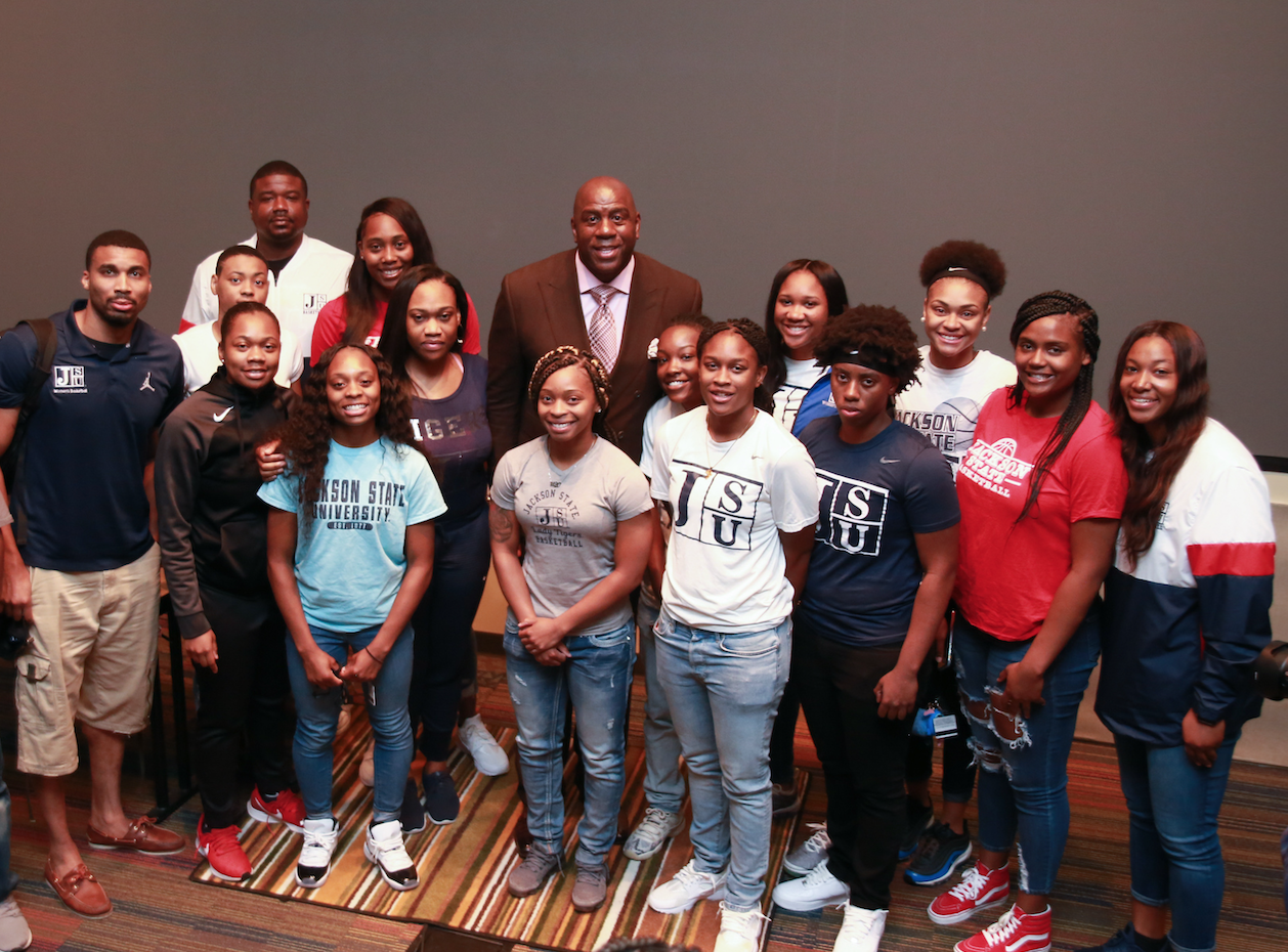 "Earvin ""Magic"" Johnson, retired Los Angeles Laker point guard, posed for pictures with JSU students after talking about his life in the NBA and fielding questions about his drive, transition into business, rebounding after bad games, and  what it felt like to play in the NBA finals, among other things. The four-time NBA champion dropped by the HBCU last Thursday, Oct. 10. (Photo by Aron Smith/JSU)"