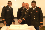 Second Lt. Christopher Hines and 2nd Lt. Antoine M. Hobson cut the ceremonial cake in their honor. They're joined by keynote speaker Col. Rodney Harris of the Mississippi Army National Guard, and Maj. Steven Robinson, department chair and professor of Military Science in JSU's College of Business. (Photo by Desmond Jones/JSU ROTC)