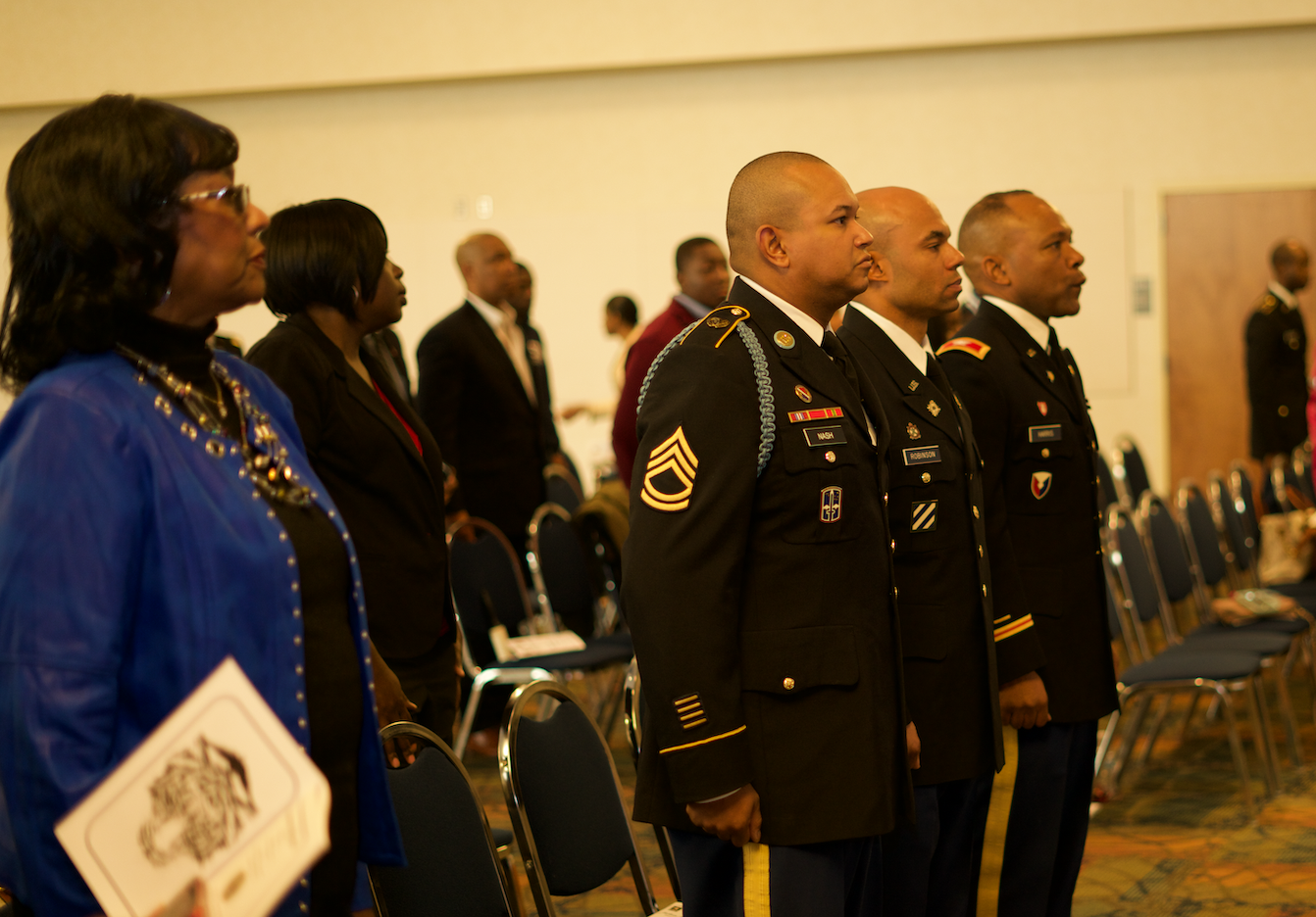 Military officers and the audience join in the presentation of the colors and the national anthem. (Photo by Desmond Jones/JSU ROTC)