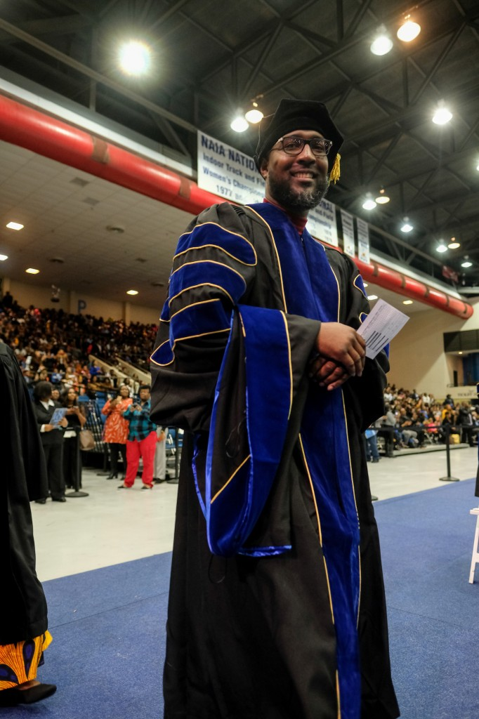 """Arron Richardson, an employee at JSU, poses with his wife after commencement exercises where he received his Ph.D. Pondering what's next, Richardson said, """"I learned at an early age that I'm the CEO of Arron Richardson and I must make decisions that not only impact my life, but generations after me. I love the position I'm currently in now at the institution. I love working with students daily helping them to realize their passion and maximizing their strengths."""" (Photo special to JSU)"""