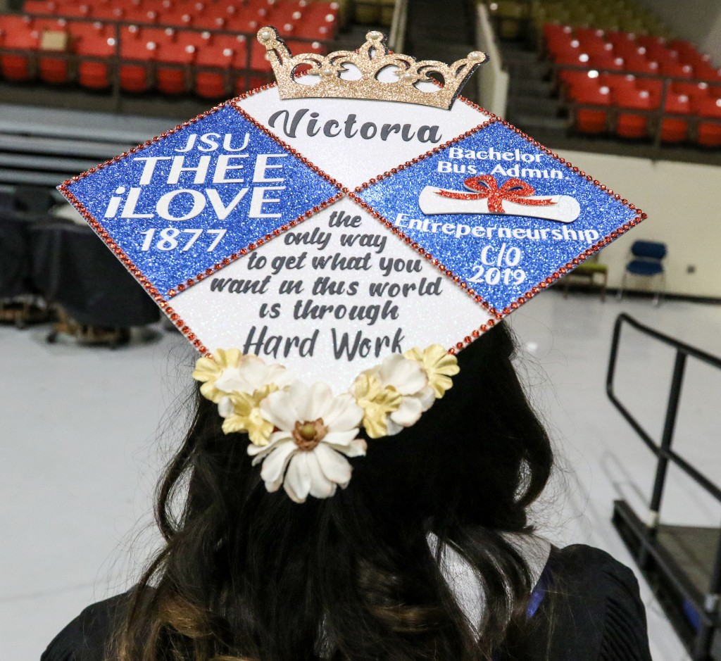 In what has now become a tradition, graduates throughout the commencement class wore their graduation caps adorned with messages displaying feelings of jubilee over their academic milestone. (Photo by Aron Smith/JSU)