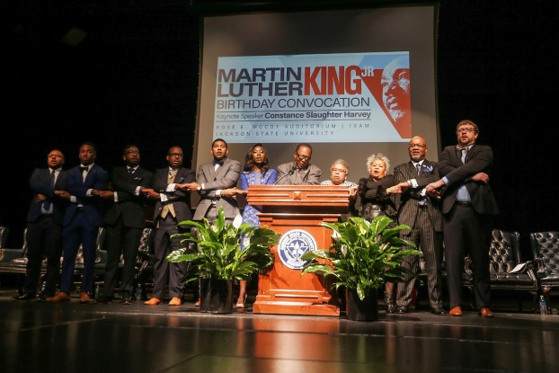"""Speakers join in the singing of """"We Shall Overcome."""" (Photo by Charles A. Smith/JSU)"""