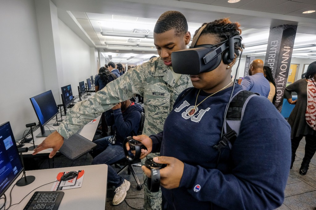 An HP assistant was available to help facilitate individuals through one of its popular VR displays. (Photo by Charles A. Smith/JSU)